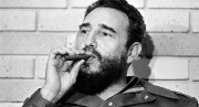 Fidel Castro, Prime Minister of Cuba, smokes a cigar during his meeting with two U.S. senators, the first to visit Castro's Cuba, in Havana, Cuba, Sept. 29, 1974.  (AP Photo)