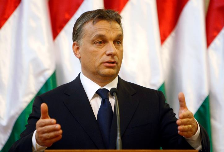 Hungary's PM Orban gestures during a joint news conference with Audi Chairman Stadler in Budapest