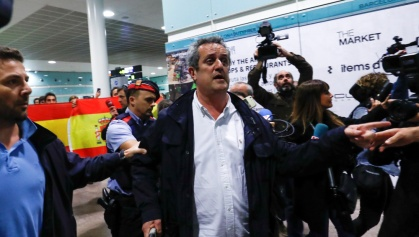 Sacked Catalan government interior minister Joaquim Forn walks after landing at the airport from Brussels, in Barcelona