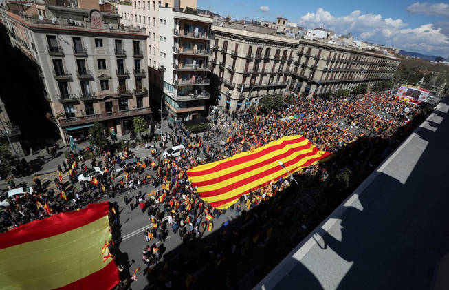 people-protest-during-a-spanish-pro-unity-demonstration-held-by-societat-civil-catalana-platform-in-barcelona-spain-march-18-2018-reuters-albert-gea