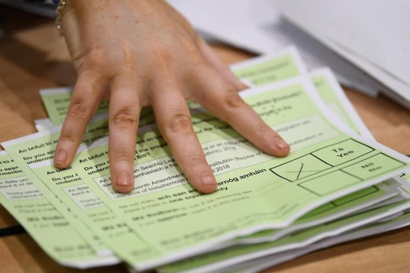 A person counts ballot sheets at the count centre for the blasphemy referendum in Dublin