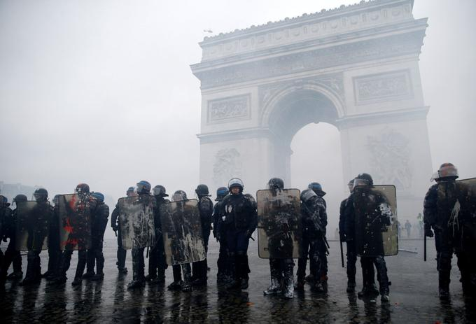 FILE PHOTO: French riot police stand guard at the Arc de Triomphe during clashes with protesters wearing yellow vests, a symbol of a French drivers' protest against higher diesel taxes, at the Place de l'Etoile in Paris