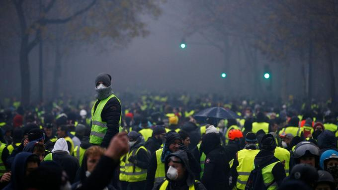 Protesters wearing yellow vests, a symbol of a French drivers' protest against higher diesel taxes, demonstrate near the Place de l'Etoile in Paris